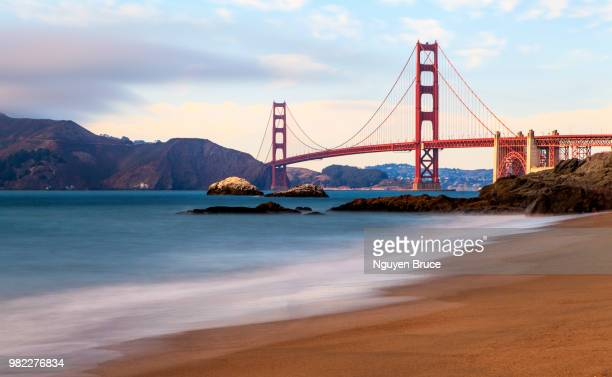 A beach next to the Golden Gate Bridge in San Francisco, California, USA