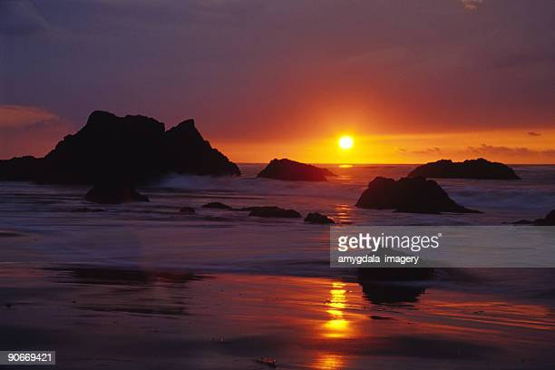 beach ocean sunset tide boulders landscape - malibu beach stock pictures, royalty-free photos & images