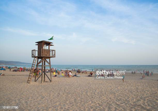 beach of barbate (cadiz, spain) in a clear day of summer - strandwächterhaus stock-fotos und bilder