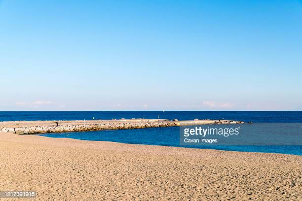 beach of barcelona with blue sky and sand beach - la barceloneta stock pictures, royalty-free photos & images