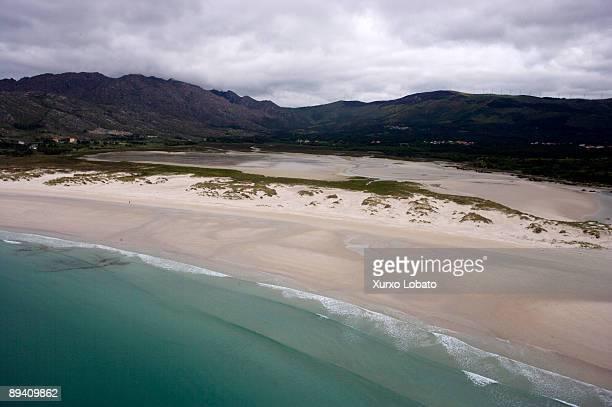 Beach of Carnota and Pool of Caldabarcos In the back Monte Pindo in the Costa da Morte A Coruna Galicia