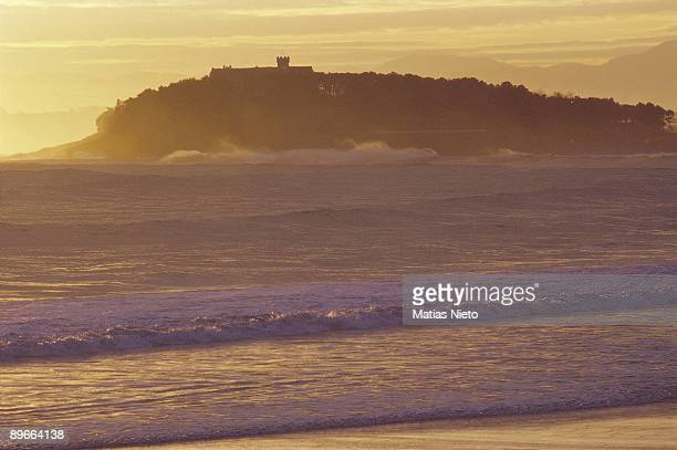 Beach of El Sardinero and Palace of La Magdalena Santander Cantabria Strong surf in the promontory of La Magdalena It highlights the silhouette of...