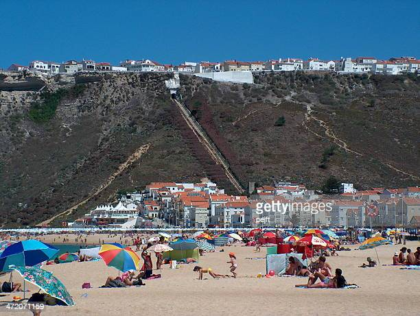 beach of nazare, portugal - pejft stock pictures, royalty-free photos & images