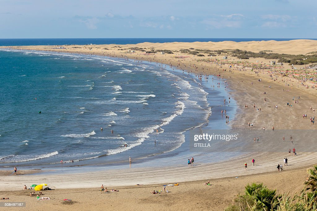 Beach of Playa del Ingles, the dunes of Maspalomas at the back, southern coast of the island, Gran Canaria, Canary Islands, Spain : Stock Photo