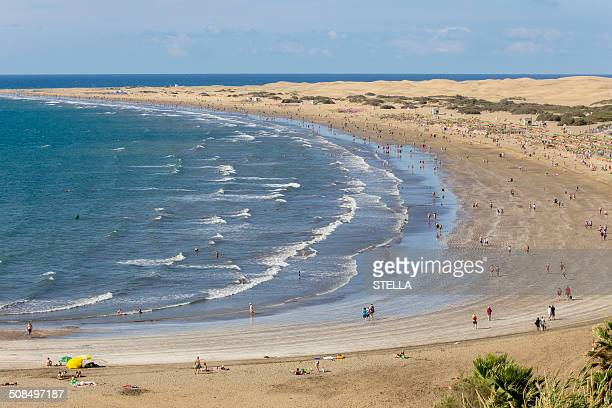 Beach of Playa del Ingles, the dunes of Maspalomas at the back, southern coast of the island, Gran Canaria, Canary Islands, Spain