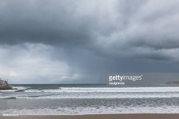 A beach on a stormy day