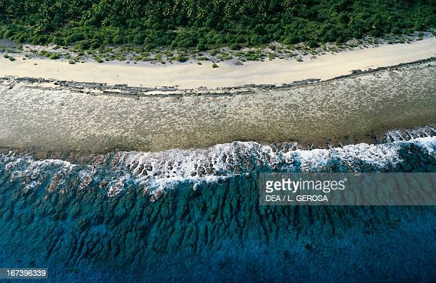 Beach on the coral island of Maupiti Society Islands French Polynesia Aerial View