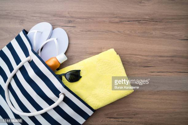 beach outfit - tote bag stock pictures, royalty-free photos & images