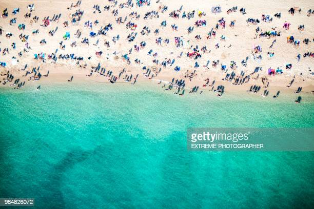 beach overhead view - crowded beach stock pictures, royalty-free photos & images