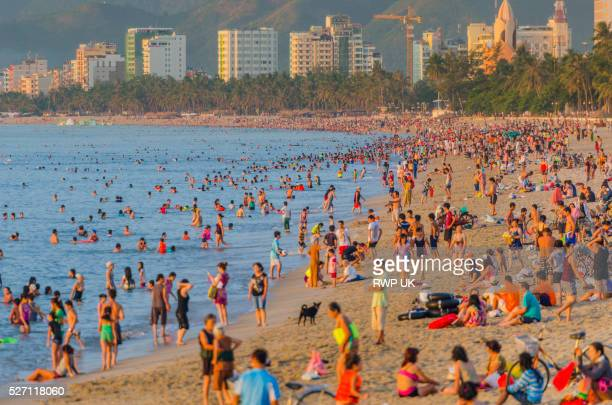 Beach Packed with Vietnamese Tourists at dawn. Nha Trang, Vietnam