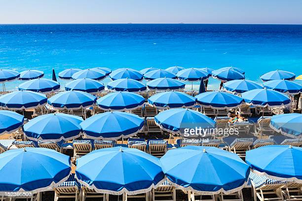 beach parasols, nice - mediterranean sea stock pictures, royalty-free photos & images