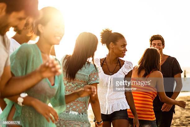 Beach party at dusk