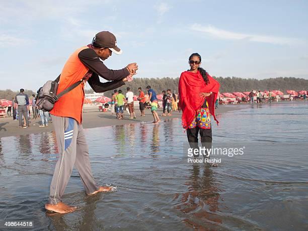 COX'S BAZAR BANGLADESH COX'S BAZAR CHITTAGANG BANGLADESH A beach photographer taking photograph of his client in Coxs Bazar sea beach Bangladesh...