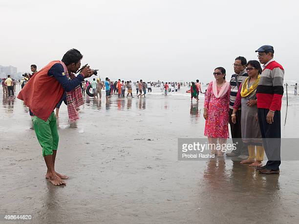 COX'S BAZAR BANGLADESH COX'S BAZAR CHITTAGANG BANGLADESH A beach photographer taking photograph of his client in Coxs Bazar sea beach Bangladesh...