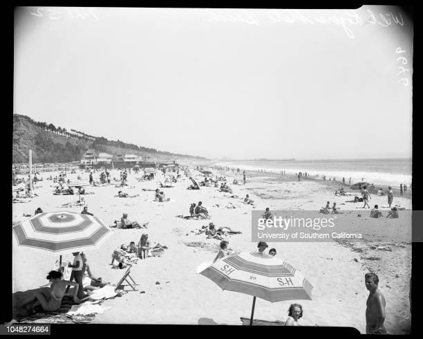 Beach pictures, Will Rogers State Beach, 26 July 1952. Jane Easton -- 23 years;Zane Megowan -- 3 years.;Caption slip reads: 'Photographer: Sandusky....