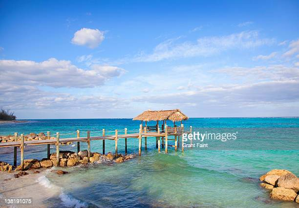 beach pier near sea. - nassau stock pictures, royalty-free photos & images