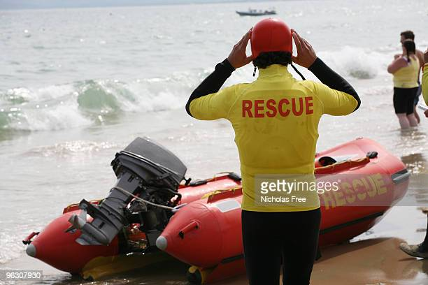 beach rescue - lifeguard stock pictures, royalty-free photos & images