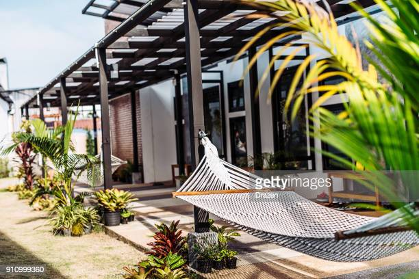 beach resort with hammocks near the bungalows in thailand - hostel stock pictures, royalty-free photos & images