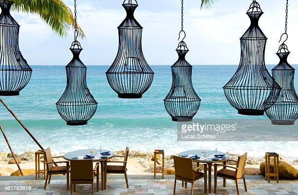 August 15: A beach restaurant awaits guests in the Mandarin Oriental hotel resort on the on the Dadonghai bay, coast of Sanya on August 15, 2010 in...