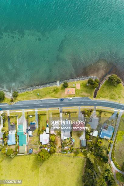 beach, road and houses. - nazar abbas photography stock pictures, royalty-free photos & images