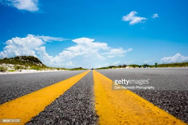 beach road near pensacola, florida - pensacola beach stock pictures, royalty-free photos & images