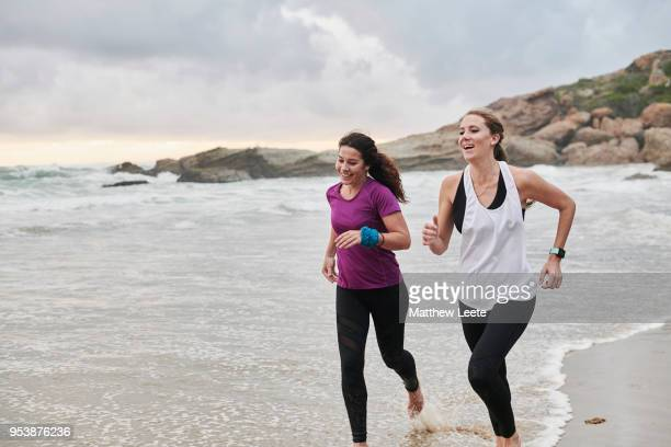 beach runners - matthew hale stock pictures, royalty-free photos & images