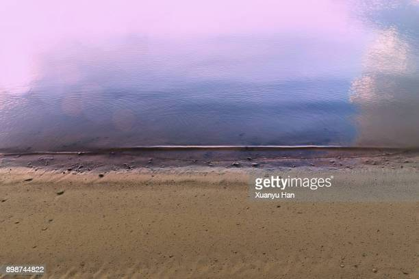 beach sand - waterkant stockfoto's en -beelden