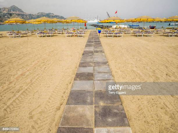 beach scene at giardini naxos, taormina. - naxos sicily stock pictures, royalty-free photos & images
