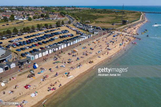 beach scene photographed from an aerial perspective, southend-on-sea, essex, united kingdom - heatwave stock pictures, royalty-free photos & images