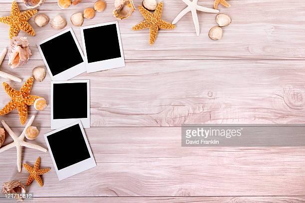 Beach scene with blank photograph  prints.