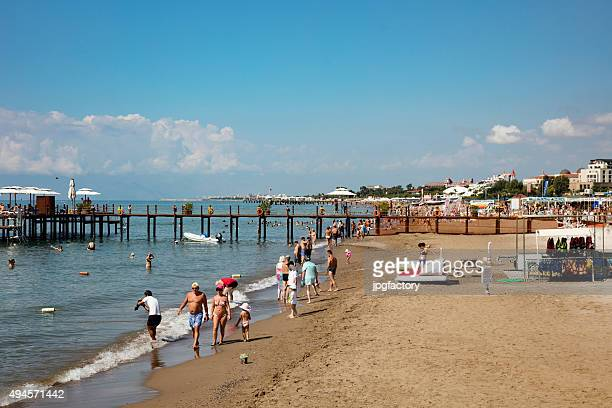 beach scene with people - belek stock pictures, royalty-free photos & images