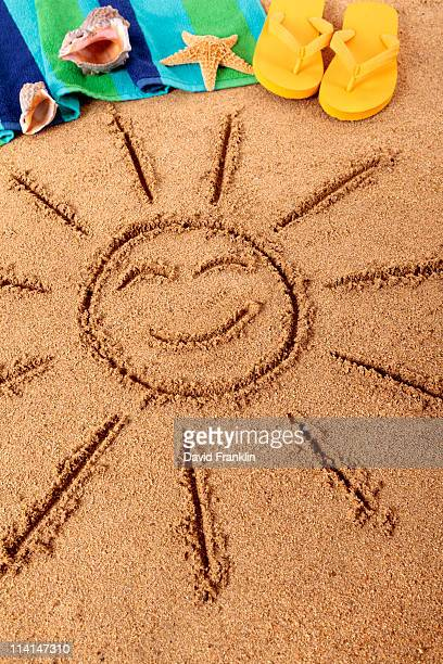 Beach scene with smiling sun
