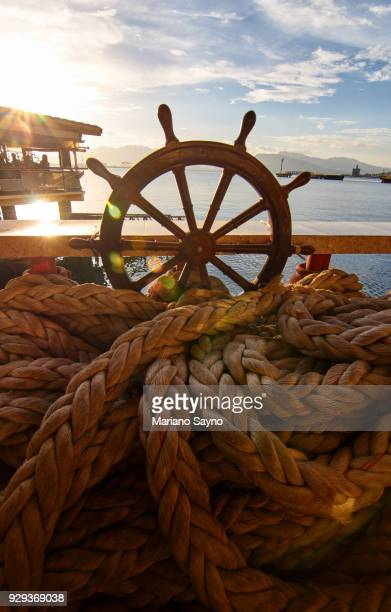 beach scene with steering wheel - old manila stock pictures, royalty-free photos & images