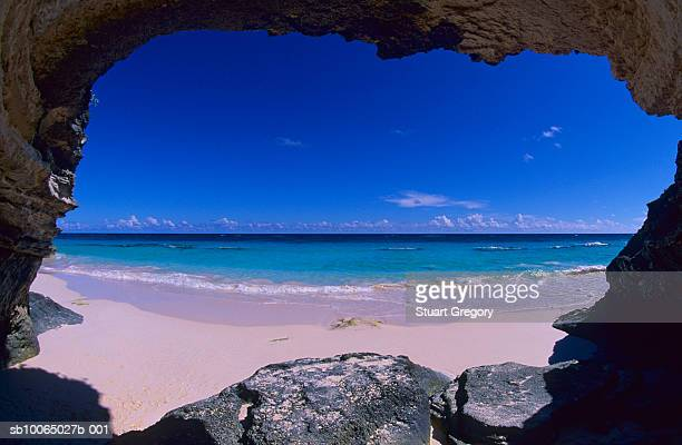 beach seen from opening of cave - bermuda stock pictures, royalty-free photos & images