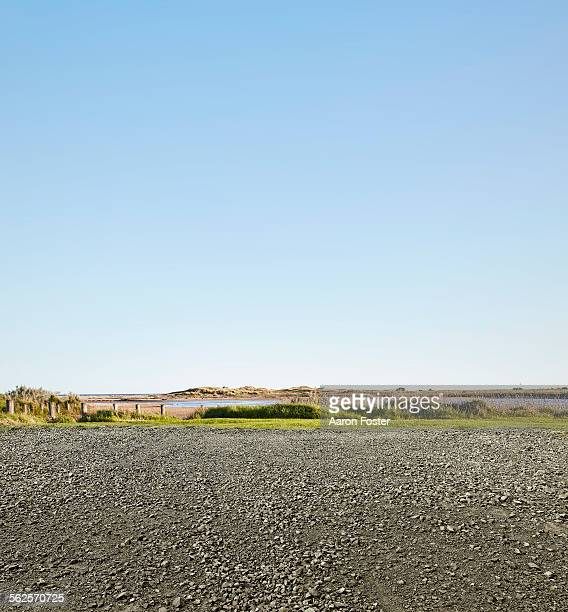 beach side parking - gravel stock pictures, royalty-free photos & images