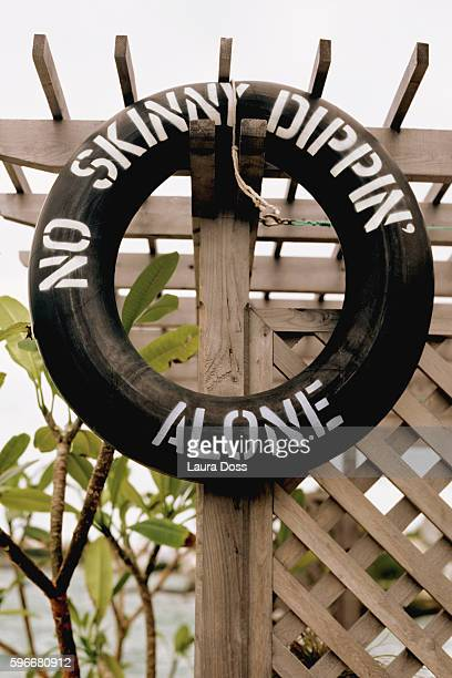 beach sign - skinny dipping stock photos and pictures
