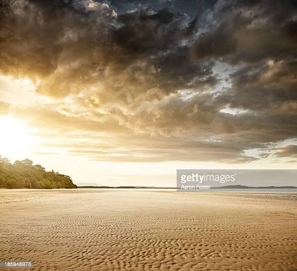 beach sunset - dramatic sky stock pictures, royalty-free photos & images