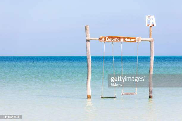 beach swing in the water - holbox island fotografías e imágenes de stock