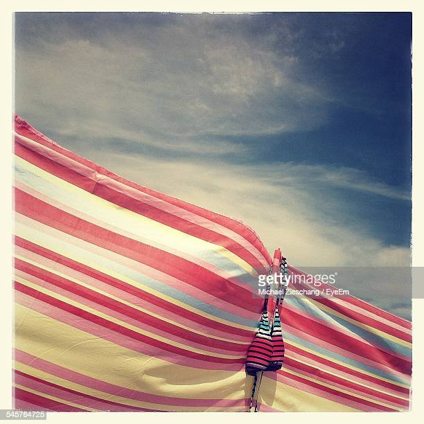 Beach Towel Against Sky During Sunny Day