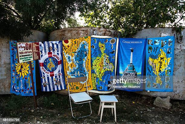 Beach towels with pictures of the Crimean Peninsiula are sold in Sevastopol on August 13 2015 in Sevastopol Crimea Russian President Vladimir Putin...
