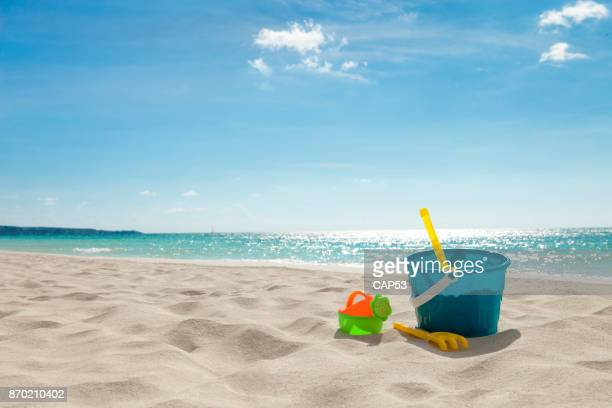 beach toys in the sand - sand stock pictures, royalty-free photos & images