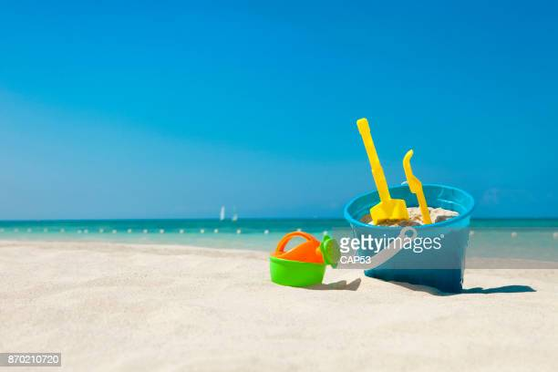 beach toys in the sand - bucket stock pictures, royalty-free photos & images