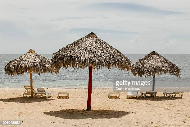 Beach umbreallas on playa Ancon near Trinidad, in Cuba