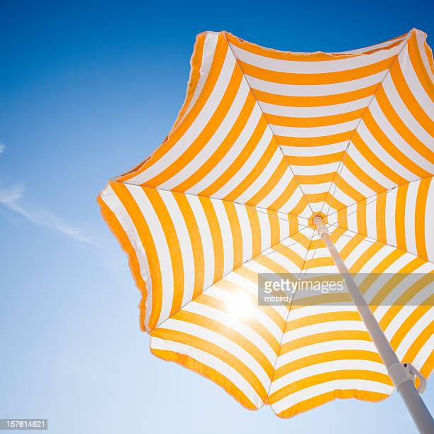Beach umbrella against blue morning sky
