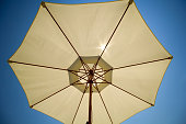 beach umbrella against the blue sky