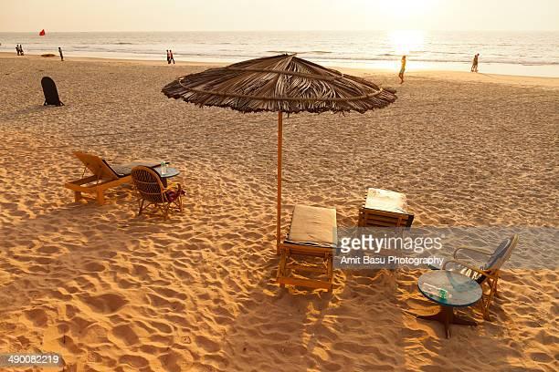 Beach umbrella at sunset. Benaulim, Goa, India