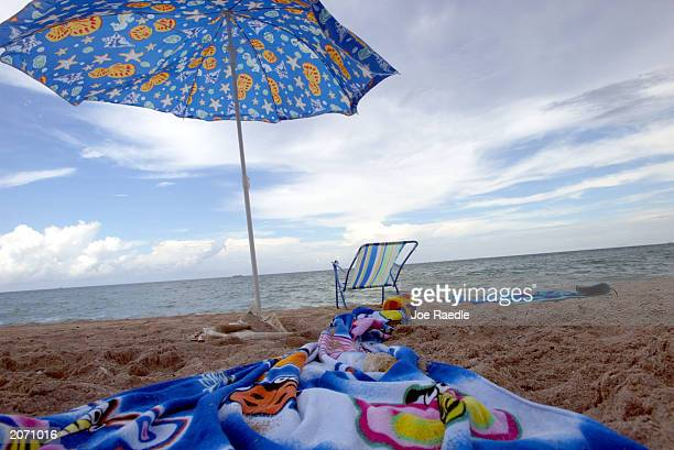 A beach umbrella is shown propped up on the beach June 10 2003 in Hollywood Florida According to the Pew Oceans Commission report released recently...
