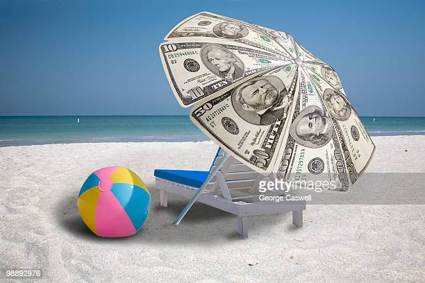 Beach umbrella made out of money