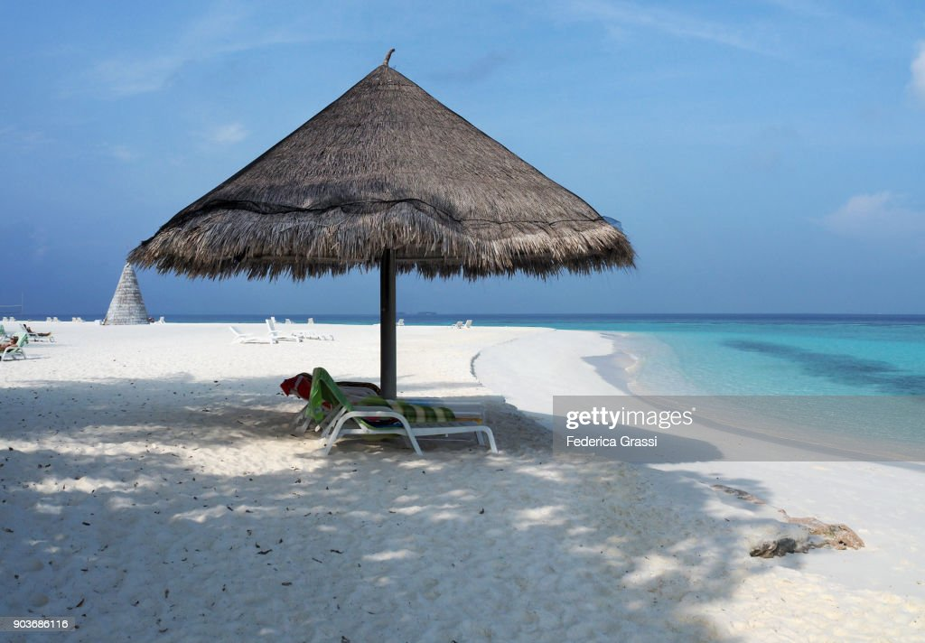 Beach Umbrella Made With Palm Tree Leaves On Maldivian Stock Photo