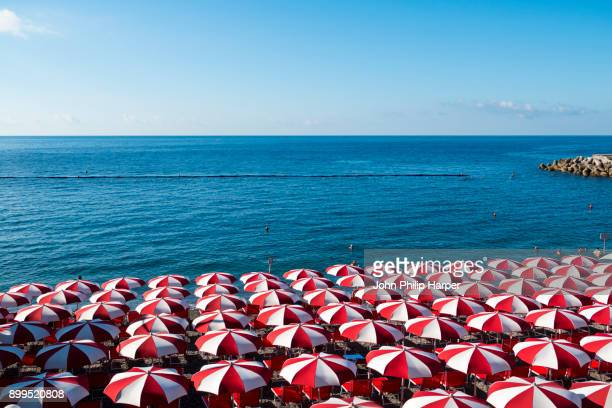 beach umbrellas, amalfi coast, italy - crowded beach stock pictures, royalty-free photos & images